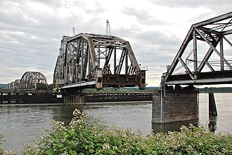 Swing bridge - BNSF Railway bridge across the Columbia River in Portland, Oregon, showing the swing-span section turning.