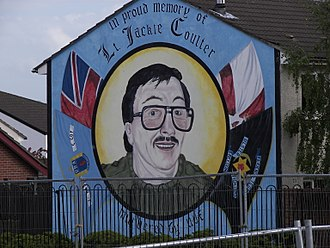 Shankill Road - Jackie Coulter, a member of C Company of the UDA, commemorated on a mural on Hopewell Crescent.