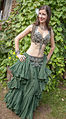 Belly dancer in green posing for the paparazzi! (8008084574).jpg