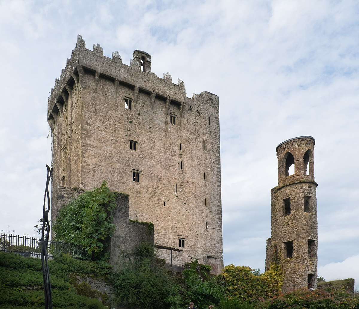 Blarney Castle, as viewed by the visitor today, is the third to have been erected on this site. The first building in the tenth century was a wooden structure. Around A.D. this was replaced by a stone structure which had the entrance some twenty feet above the ground on the north face. This bui.