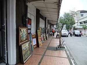 Five foot way - Kaki lima or five-foot way along Braga Street in Bandung, Indonesia, occupied by street artist selling paintings.