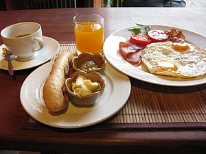 English: Breakfast with bread, butter, jam, fr...