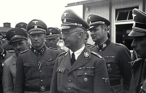 Eigruber (far left), Ziereis (left), Himmler (front), Wolff (right) and Franz Kutschera (far right) (April 1941) - Mauthausen-Gusen concentration camp