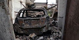 Battle of Ilovaisk - Burnt civilian car in Ilovaisk after shelling