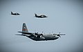 C-130 Hercules, 182nd Airlift Wing, Illinois Air National Guard escorted by Alpha Jet for Top Aces Inc.jpg