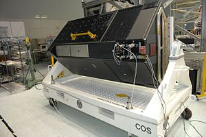 Cosmic Origins Spectrograph - The Cosmic Origins Spectrograph on its handling cart in the Spacecraft Systems Development Facility cleanroom at the Goddard Space Flight Center