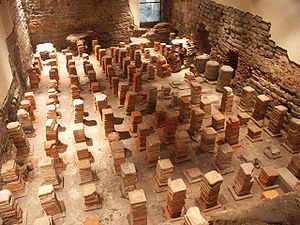 Hypocaust - Caldarium from the Roman Baths at Bath, in Britain. The floor has been removed to reveal the empty spaces through which the hot air would flow.