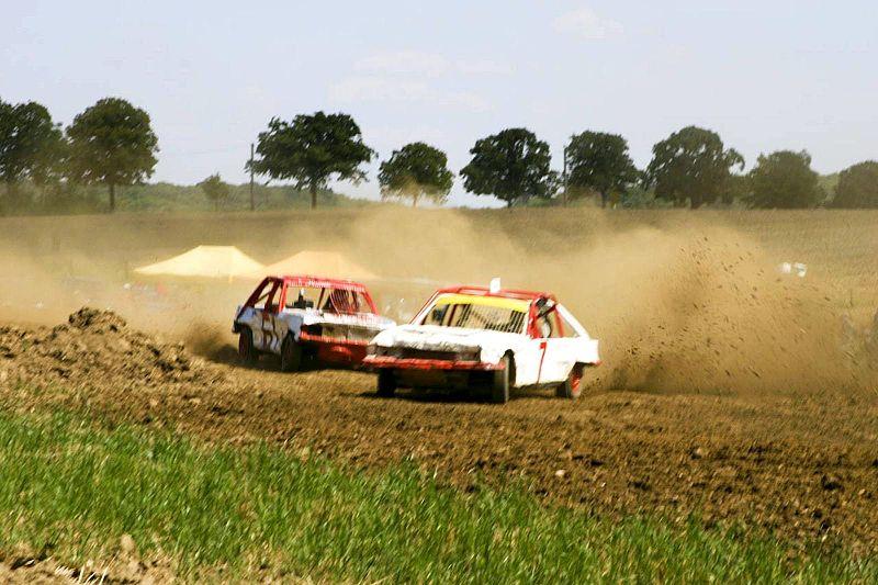 File:Car race on dirty roads.jpg