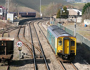 Vale of Glamorgan Line - A Cardiff-bound Arriva Trains Wales Class 150 passing through Aberthaw Station, which closed in 1964. At the time of the photo, the up platform track had already been lifted and the down platform track was removed later.