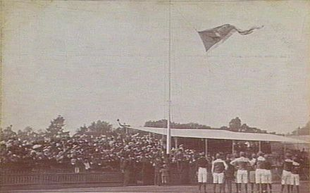 The 1906 VFL premiership flag being hoisted at Carlton Oval Carlton premiership flag 1907.jpg