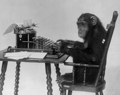 Chimpanzee seated at typewriter