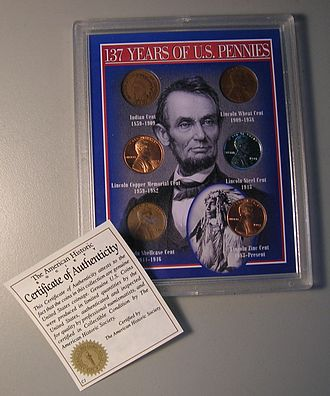Certificate of authenticity - A certificate of authenticity with a coin set