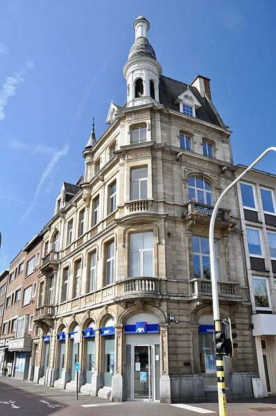 "Corner building ""Postkantoor van 1906"" at Antwerpsestraat 1, Mortsel, Antwerp, Belgium. Built in 1906. Design by Jean-Jacques Winders. Used as a bank (at least the ground floor), at the time when the photograph was taken."