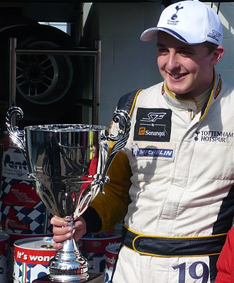 Craig Dolby - Dolby holding a trophy from one of his race wins at the 2010 Silverstone Superleague Formula round