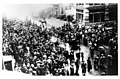 Crowds fill the street and watch as the Asch Building, location of the Triangle Waist Company, burns, March 25, 1911 (5279143669).jpg