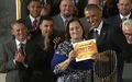 Cubs visit to the White House, Laura Ricketts presents Obama with lifetime pass to Wrigley Field (04).png