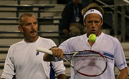Damm (links) met Lindstedt op de US Open in 2009