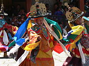 Left: Dance of the Black Hats with Drums. Right: Paro Tsechu festival of dances