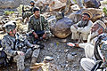 Defense.gov News Photo 101106-A-2911M-131 - U.S. Army 2nd Lt. Daniel Wild left and an Afghan army weapons team leader 2nd from left talk with Gurem village elders in Nangarhar province.jpg