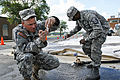 Defense.gov News Photo 110626-A-TU749-252 - Army Sgt. Burton Atkinson tests water samples that his team purified in Minot N.D. on June 26 2011. His team of water purification specialists.jpg