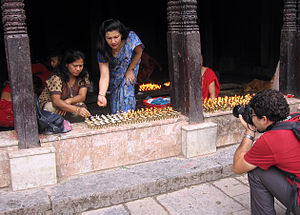 Uray (caste group) - Lighting butter lamps at Swayambhu, Kathmandu