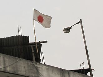 Donyi-Polo - Donyi-Polo flag. Seen over a house in Itanagar, indicates that its inhabitants follow the religion.