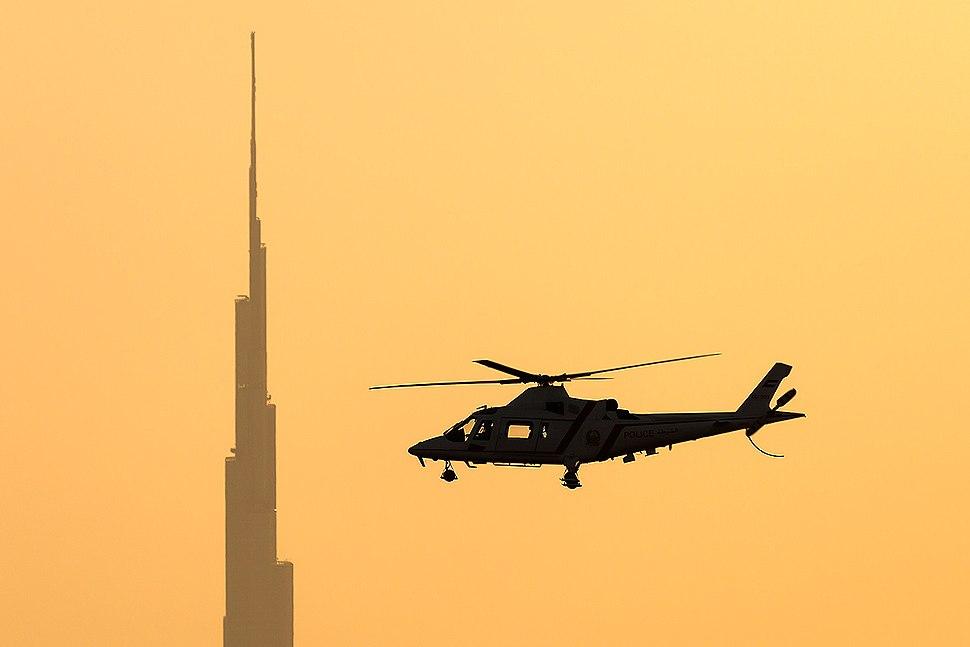 Dubai Police Agusta A-109K-2 in flight at sunset