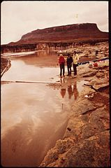 EPA Men Inspecting Oil Leakage Along Boom Site- Part of the Clean - Up of the San Juan River Oil Spill, 10-1972 (3857065234).jpg
