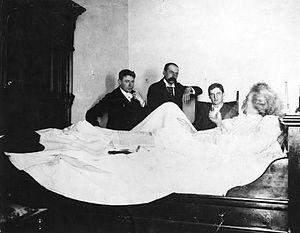 Ernest John Harrison - Ernest John Harrison (sitting first on the right) and other reporters interviewing Mark Twain from his hotel bed in Vancouver on August 18, 1895.