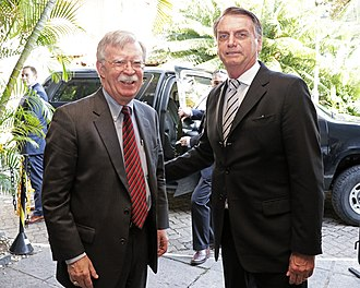 Climate change denial - Brazilian President Jair Bolsonaro with Donald Trump's National Security Adviser John Bolton in Rio de Janeiro, 29 November 2018