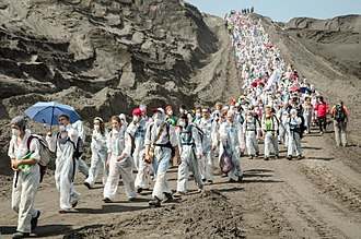 Fossil fuel phase-out - 3,500-4,000 environmental activists blocking a coal mine to limit climate change (Ende Gelände 2016).