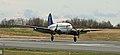 Everts Air Cargo C-46 landing at ANC (6259046467).jpg