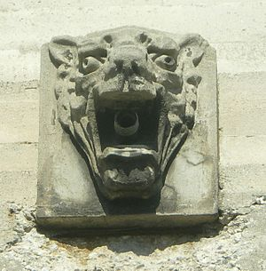 Municipal Warehouse No. 1 - Dozens of these decorative faces adorn the exterior of Municipal Warehouse No. 1