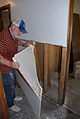 FEMA - 30618 - Removing damaged sheetrock from a home.jpg