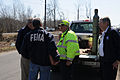 FEMA - 34696 - FEMA CR Speak with State Debris Removal Worker.jpg