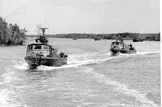 Patrol Craft Fast - Swift boats on patrol lead a group of monitors and armored landing craft.