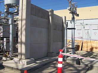 Firewall (construction) - Example of a firewall used to inhibit the spread of a fire at an electrical substation.