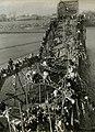 Flight of Refugees Across Wrecked Bridge in Korea.jpg