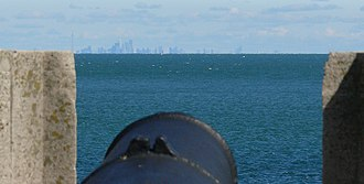 Lake Ontario - Historic cannon at Fort Niagara; Toronto across the lake