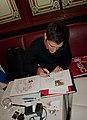 Gérald Guerlais en dédicace, Café du Commerce, Paris 2012.jpg