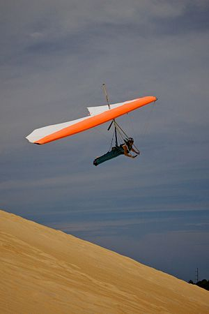 Jockey's Ridge State Park - Hang gliding is a popular activity due to the large sand dunes and wind from the Atlantic Ocean.
