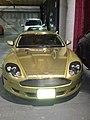 Gold Aston Martin DB9 atLondon Motor Museum (Ank Kumar) 02.jpg