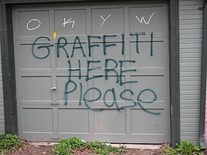Graffiti in Toronto - A garage door in a Toronto alley way.