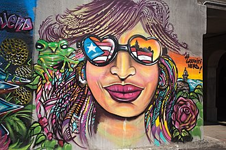 Coquí - Graffito of a coqui on a woman's shoulder on the Bloomingdale trail in Humboldt Park, Chicago, a densely Puerto Rican neighborhood