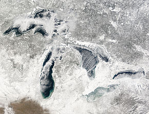 terra modis image of the great lakes january 27 2005 showing ice beginning to build up around the shores of each of the lakes with snow on the ground