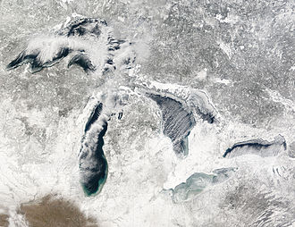 Great Lakes - Terra MODIS image of the Great Lakes, January 27, 2005, showing ice beginning to build up around the shores of each of the lakes, with snow on the ground.