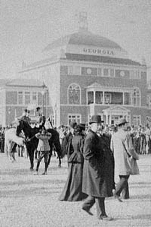 Piedmont Exposition - President Grover Cleveland walks past the Georgia Building at the 1887 Exposition.