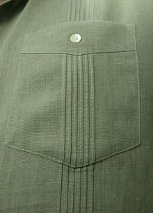 d5c4917c Closeup of a pocket on a Cuban guayabera, showing the button and aligned  alforzas