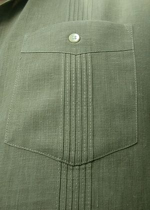 Guayabera - Closeup of a pocket on a Cuban guayabera, showing the button and aligned alforzas