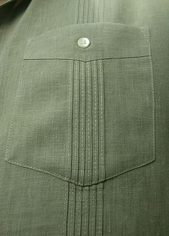 Guayabera - Closeup of a pocket on a Cuban guayabera, showing the button and aligned alforzas